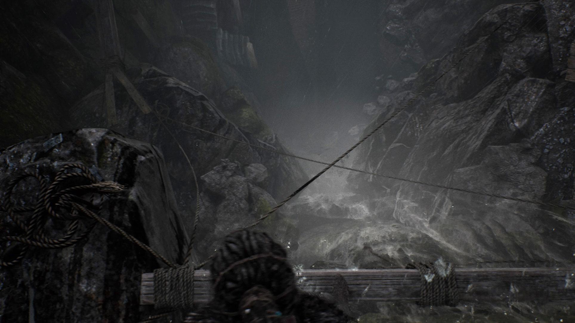 """Gerade zu Spielbeginn verwöhnt """"Hellblade"""" mit ungewöhnlichen Einblicken und Kamera-Perspektiven: Hier balanciert Senua über den Sims oberhalb eines Wasserfalls und schaut benommen in die Tiefe - denn die wehrhafte Dame leidet unter Höhenangst."""