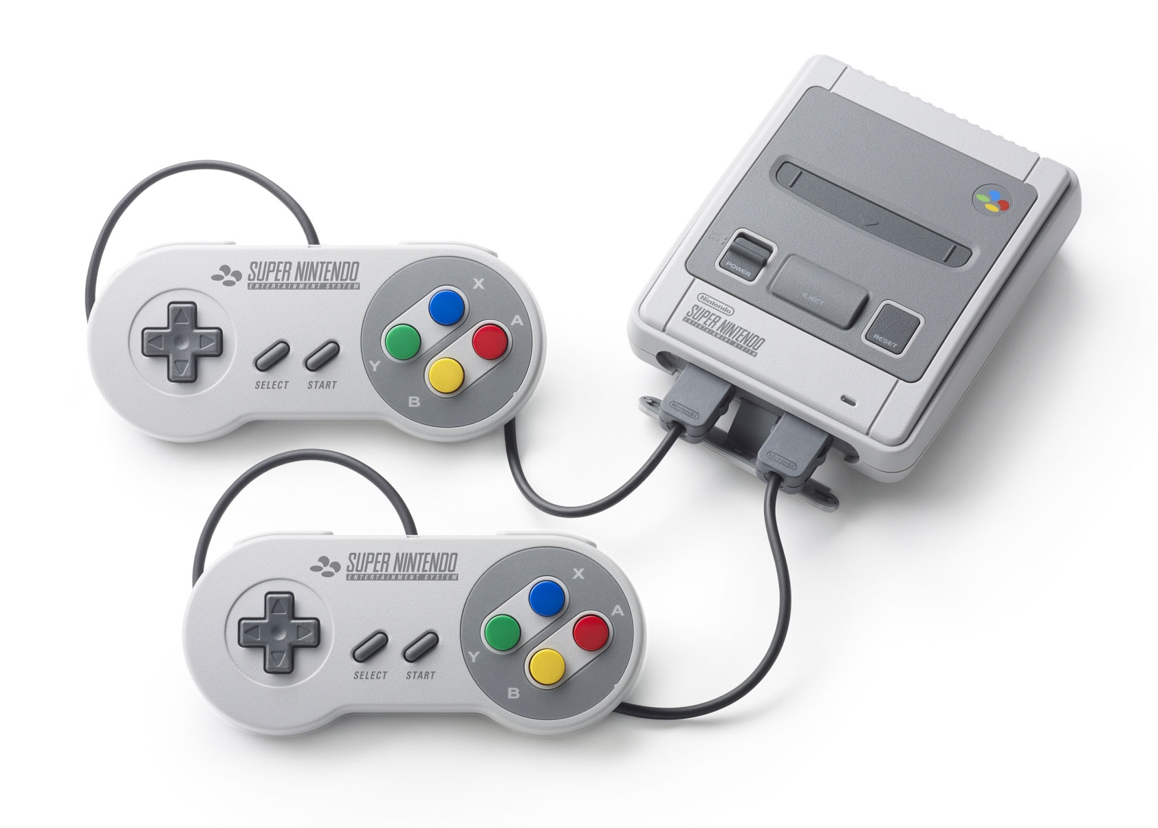 """Wie beim """"NES Mini"""" erfüllen nur Ein/Ausschalter und Reset-Button einen Zweck, Modul-Schacht und Eject-Knopf sind rein kosmetisch. Hinter einer abnehmbaren Front-Blende finden sich die Controller-Anschlüsse."""