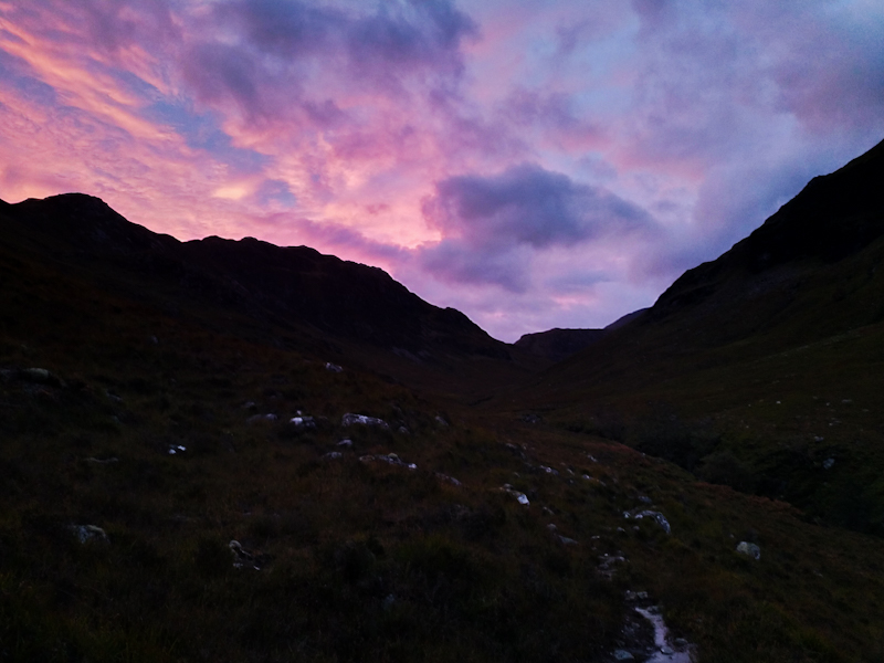 Impressive morning sky while ascending to Forcan Ridge