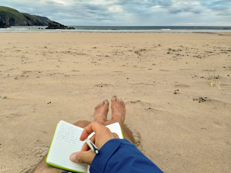 Writing my diary on the beach