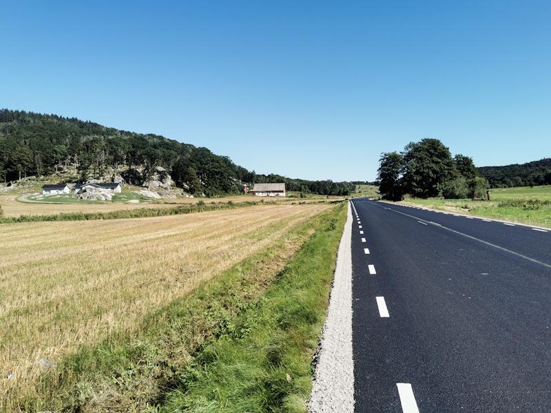 Brand new road through farmland.