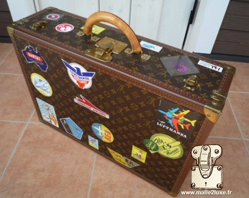 Louis vuitton bisten suitcase hotel label