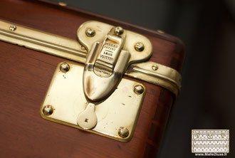 old trunk repair Louis Vuitton
