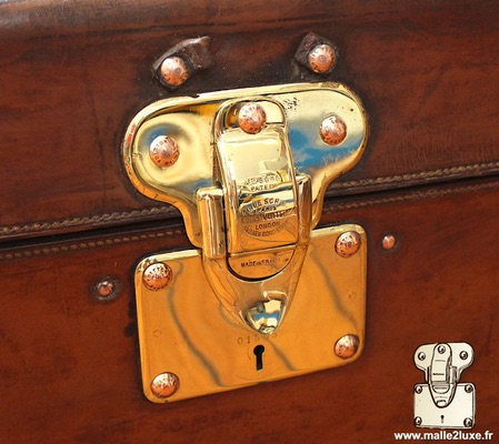 Louis Vuitton patent filing old trunk lock leather