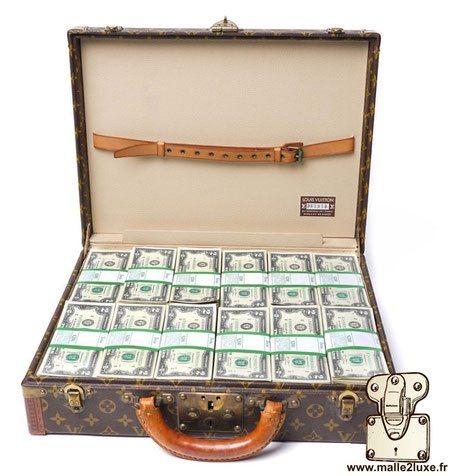 investir dans une malle de luxe Louis Vuitton argent