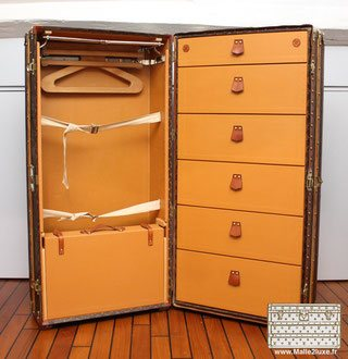 inside of a vuitton wardrobe trunk