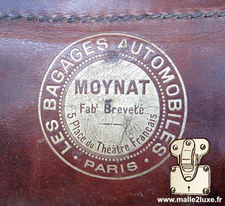 logo ancienne moynat malle automobile bagage