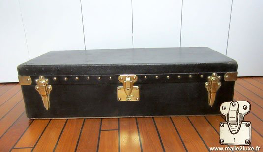 Louis Vuitton black trunk with automotive lock dust cover