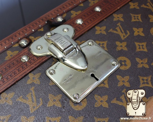Louis Vuitton patent filing old trunk lock Paris shoes