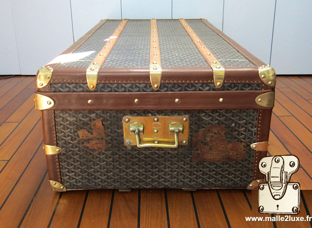 side of trunk with old Louis Vuitton label