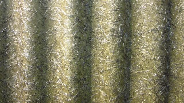 Composiet opgebouwd uit glasvezel gecombineerd met fossiele grondstof gebaseerde matrix (hars)