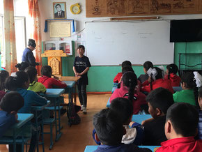 She tells classmate what she learned in Japan at her school in Mongolia.
