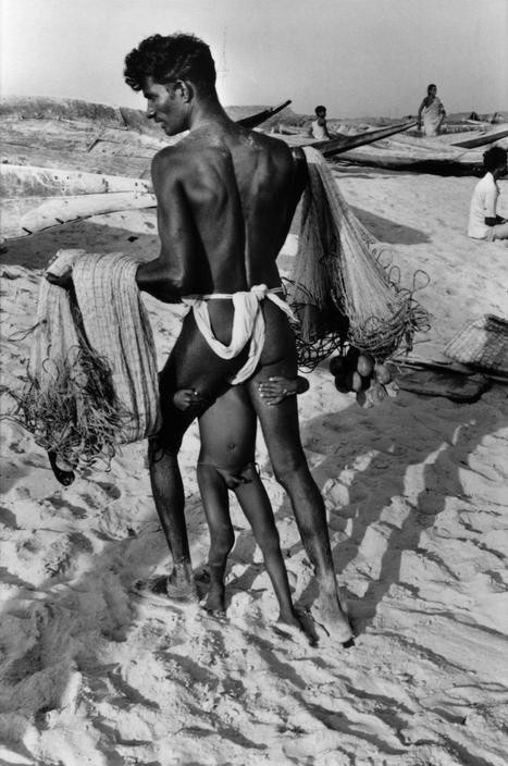 INDIA. Orissa. Puri. 1980. A fisherman and his son