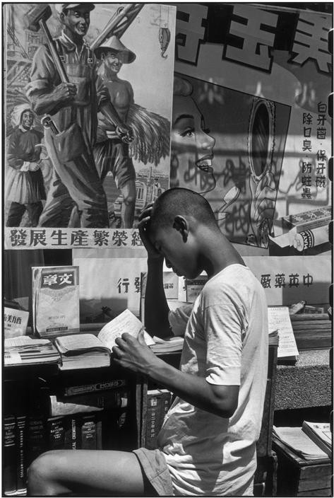 CHINA. Shanghai. 1949. The sign above the sidewalk library reads -Develop the production, make the economy prosper