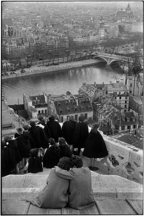 FRANCE. Paris. 1952-1953. Schoolchildren looking from the top of Notre-Dame cathedral at the Seine River