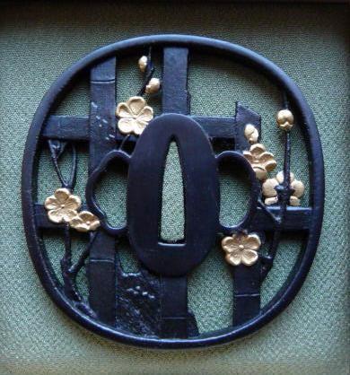 Plum / Fence - Steel golden Tsuba, rear side
