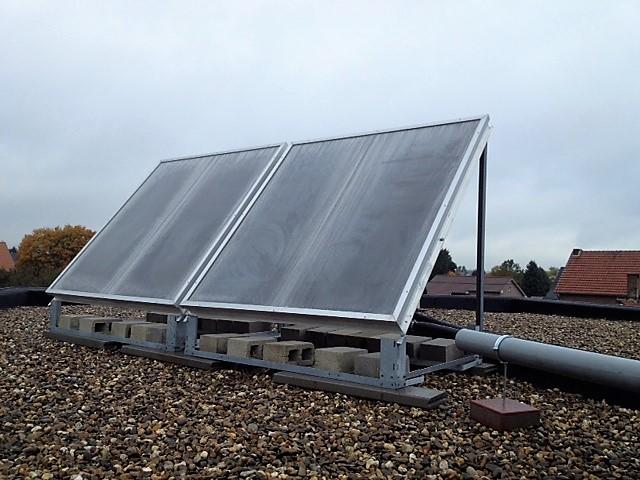 Zonneboiler 5m2 voor sanitairwarmwater en 140m2 vloerverwarming