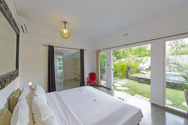 The master bedroom is spacious offering full views to swimming pool
