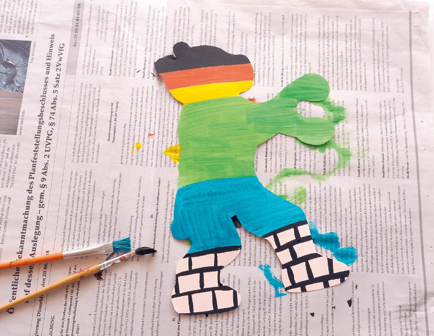 Den Bären mit Motiven zum Thema Deutschland und Berlin individuell gestalteten