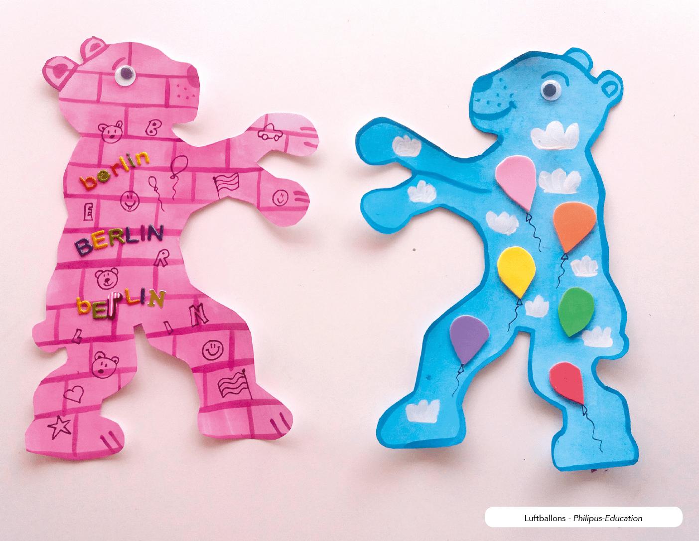 Ein rosa Bär mit Mauer-Graffiti und ein Bär mit Luftballons
