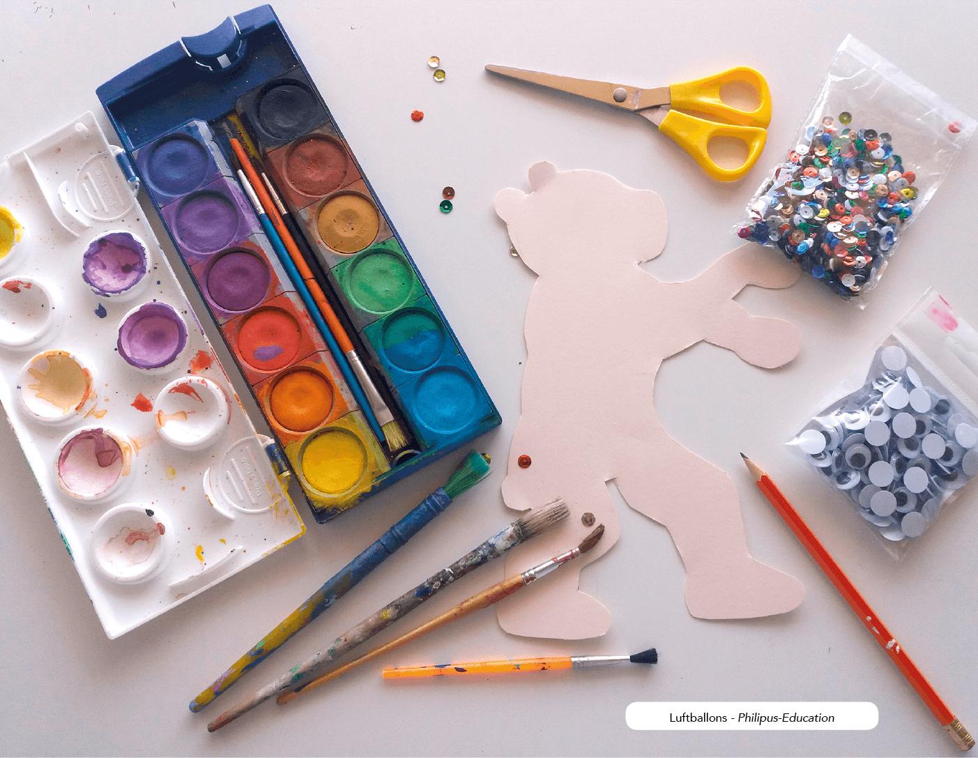 Materialien zur Gestaltung des Bärs: Wasserfarben, Wackelaugen, Pailletten - der Fantasie sind keine Grenzen gesetzt!