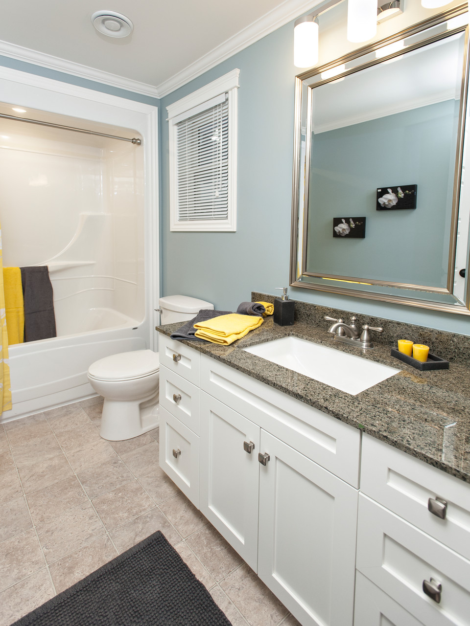 All bathroom vanities are granite solid surface counter tops with under mount sinks