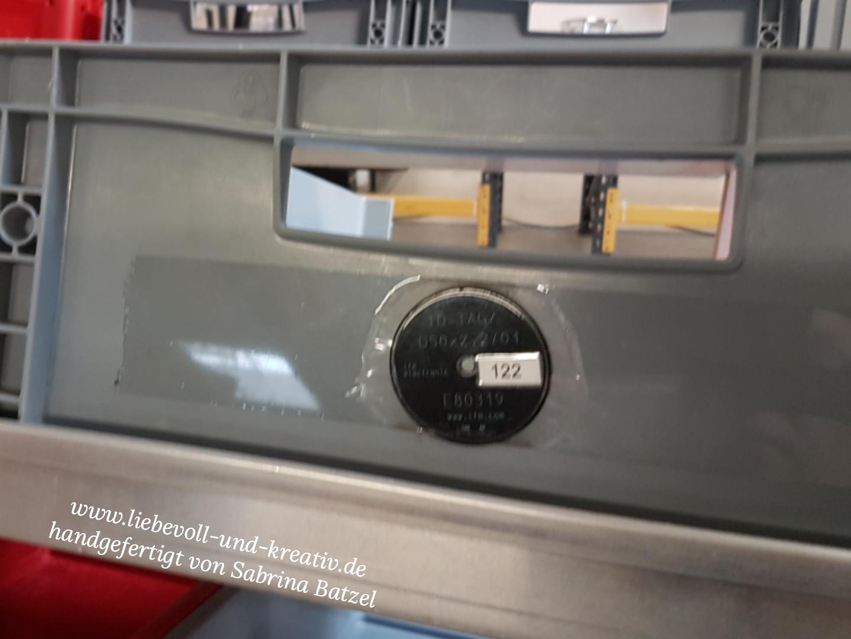 Sammelbox mit Chip, auf dem die Bestellung eingespeichert wird