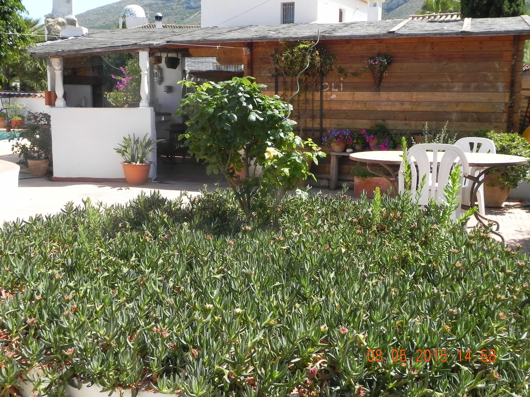 Gartenhäuschen mit Außenküche