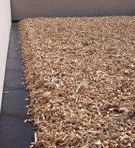 Roth GmbH - Distributor layer of spruce woodchip, grain size 40 - 100, designed as trapezium fill