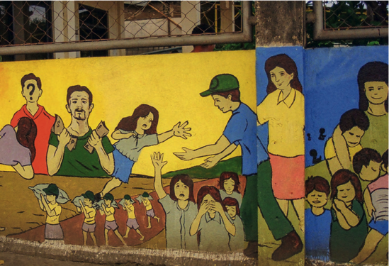 A mural in the harbor of Masbate draws attention to the danger of child trafficking. (Photo: Plan International)