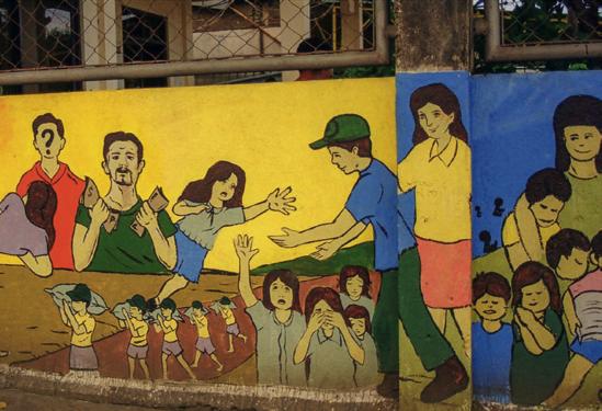 Ein Wandbild im Hafen von Masbate macht auf die Gefahr des Kinderhandels aufmerksam. (Foto: Plan International)
