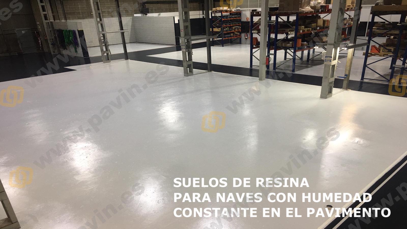 Pintar suelos de resina para naves con humedad constante en el pavimento industrial