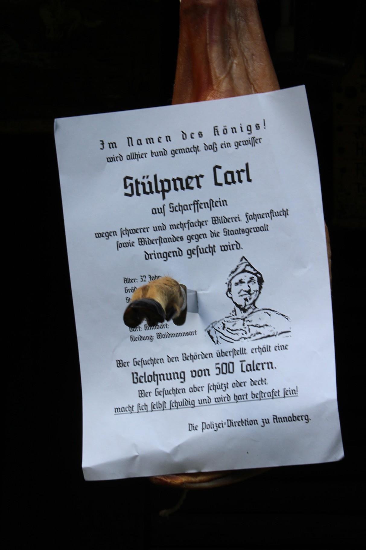 Ärger im Jahr 1795: Der Steckbrief, den die Gemeinschaft von Dörfel in dem von Stülpner gebrachten Schinken findet, verheißt nichts Gutes.