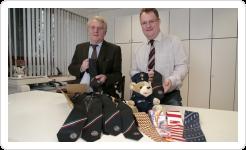 Pressespiegel: Krawatte mit Logo, Krawatte mit Firmenlogo, Krawatte in Firmenfarbe, gewebt oder gedruckt von FELD Textil GmbH