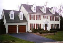North Potomac - Powerwashing of vinyl siding. Painting of exterior trim, windows, doors, garage doors and shutters.