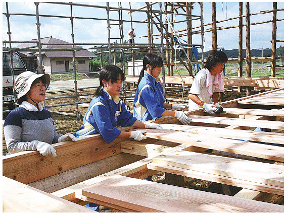 Placing new floorboards. All stage materials were renewed in 2003. (2003)