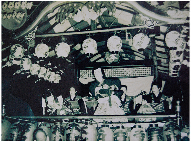 Masakado, a Tokiwazu genre play, being performed as a sideshow on a mobile stage during the Gion Sai festival in Omiya around 1950.