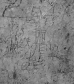 Spottcrucifix aus dem alten Rom, das die Anstößigkeit der Verehrung eines Hingerichteten illustriert