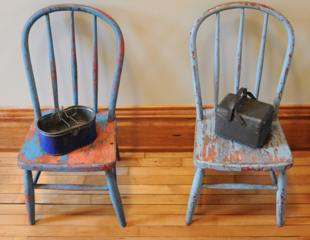 Chairs with lunch pails on display inside the newly renovated original New Groningen School. (Cory Olsen | The Grand Rapids Press)