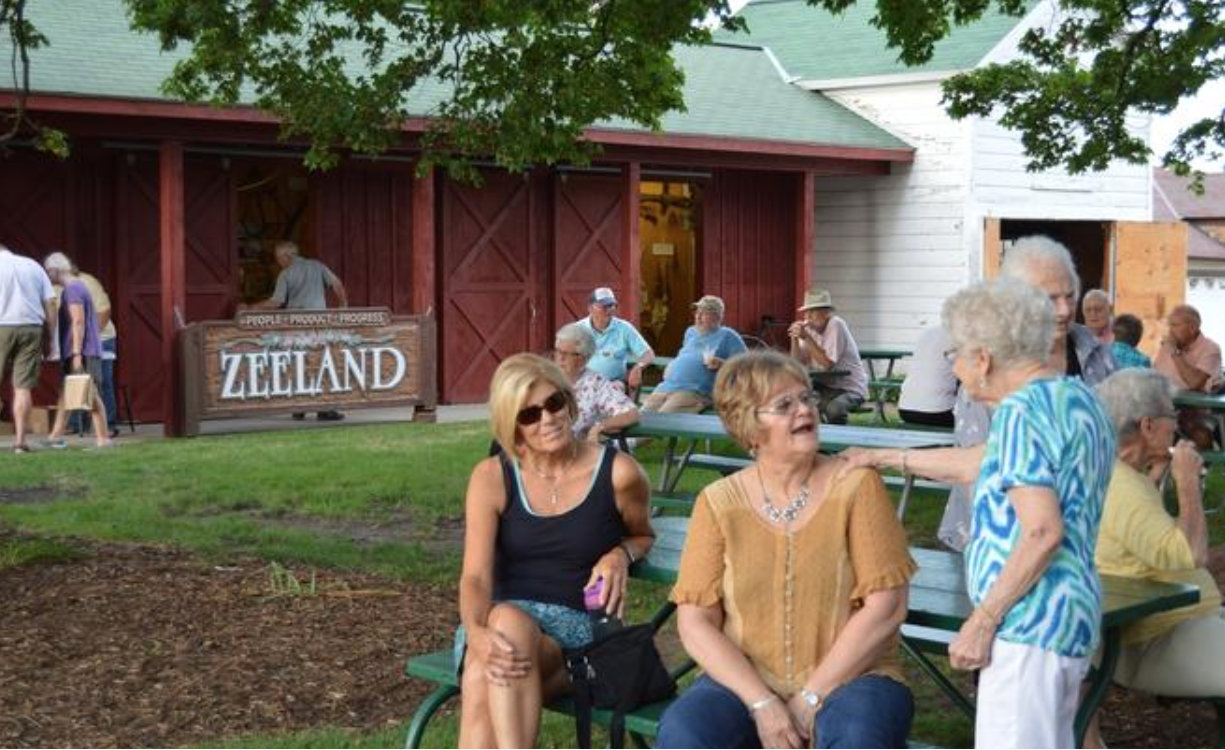 People chatted and enjoyed ice cream sundaes during the Zeeland Museum's 40th anniversary celebration and ice cream social Thursday evening, Aug. 18, 2016. Andrea Goodell/Sentinel staff