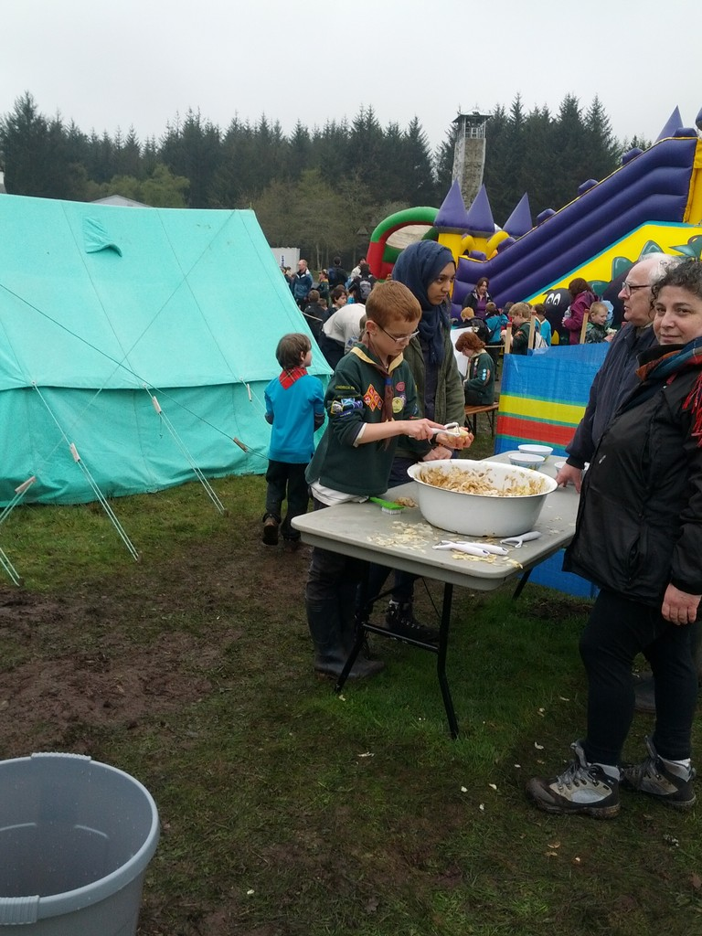 older explores help younger scouts make chips