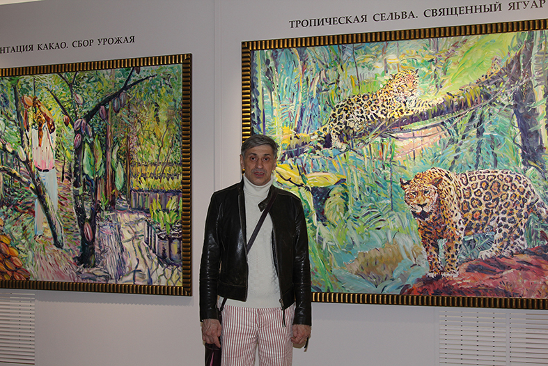 Igor Kormyshev is near to his paintings in this Museum