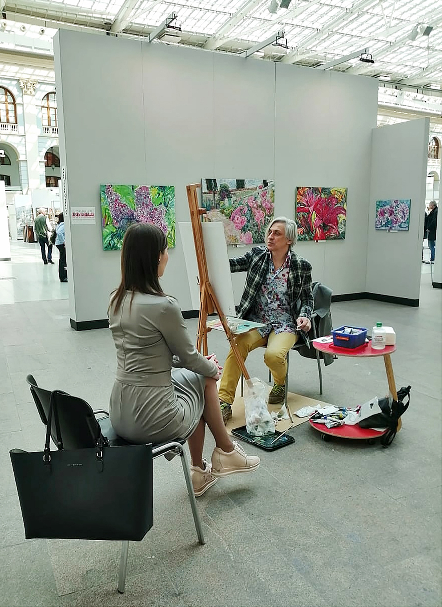 A portrait in process. At the Art April Fair. Gostiny Dvor, April 2019