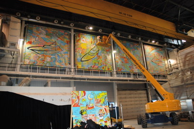Sometimes even stage lifts are not enough - that's when cranes come in to attach four 8 by 8 meter PPPs in a factory hall