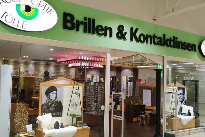Ladenfront von Augenoptik Tölle Paderborn. Das Geschäft verkauft Brillen, Kontaktlinsen und Sonnenbrillen und befindet sich im real, Südring Center Paderborn