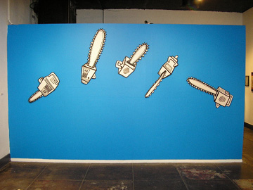 Flying Chainsaws, drawing on wood, 10' wide, 2005
