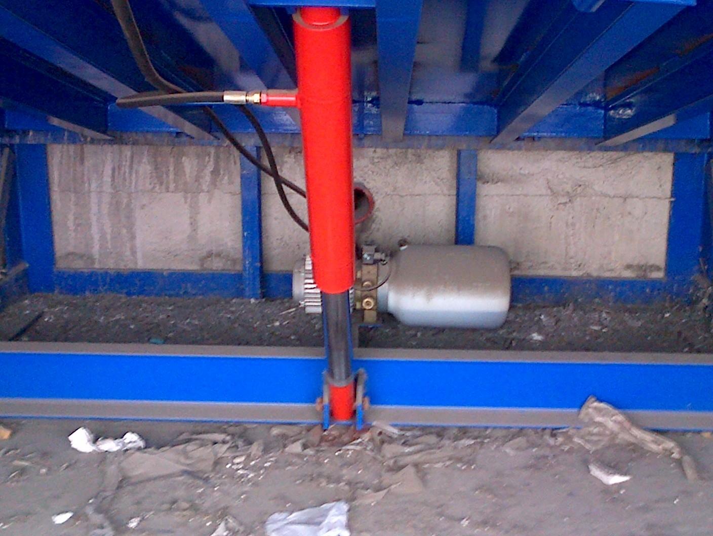 Pistón central y centralita hidraulica