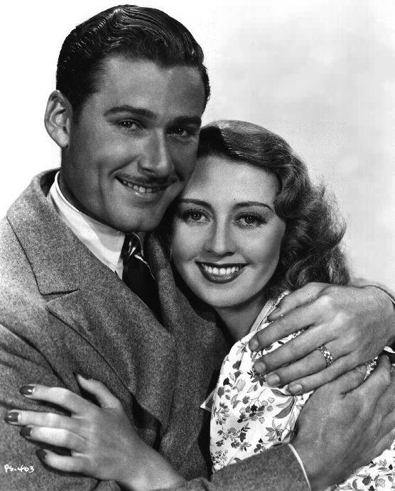 Joan Blondell (avec Errol Flynn)