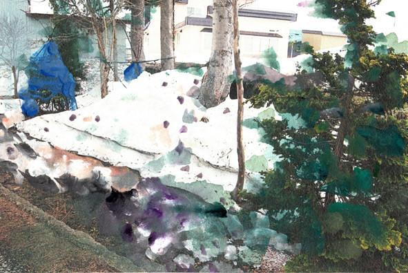 実家の庭の残雪