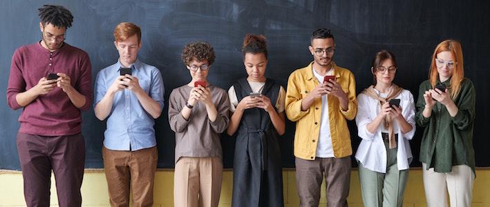 People starring at smartphones